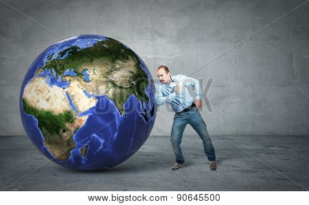 businessman try to move 3d world globe europe side