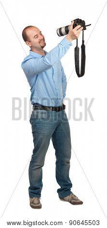 smiling man take selfie with reflex camera and big lens