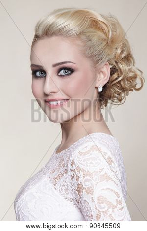 Portrait of young beautiful happy smiling blonde bride