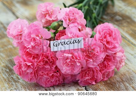 Gracias (thank you in Spanish) with pink carnations