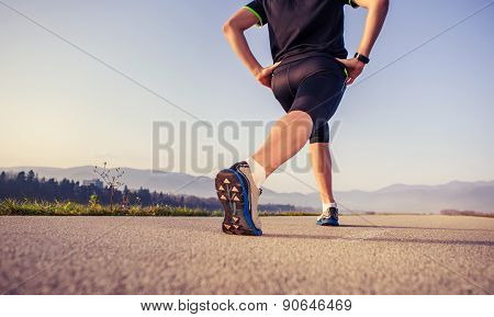 Warming Up Runner On The Road Close Up Image