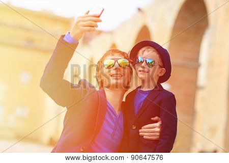 father and little son making selfie while travel in Europe