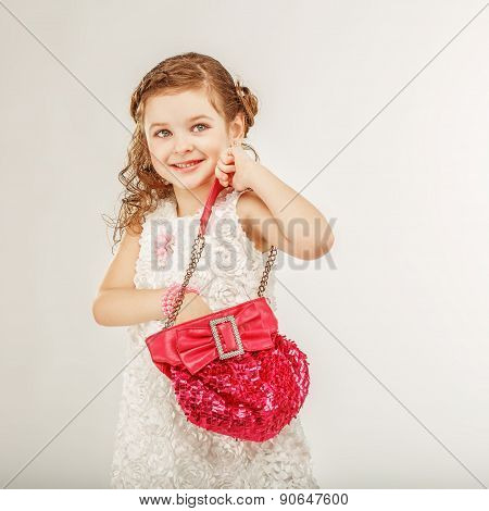 Little Girl Holding A Pink Handbag