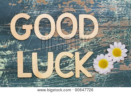 Good luck written with wooden letters on rustic wooden surface