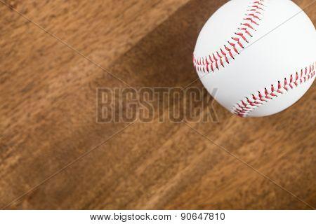 A Baseball On Wood Table