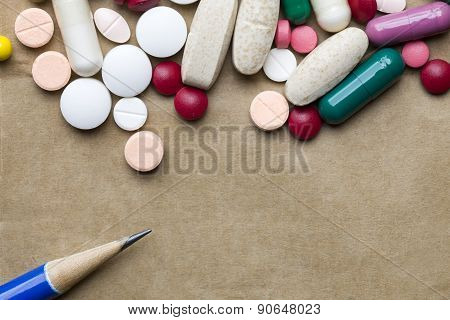 Pills On Brown Paper Background