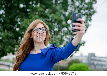 Cool pretty woman by becoming a photo with the phone