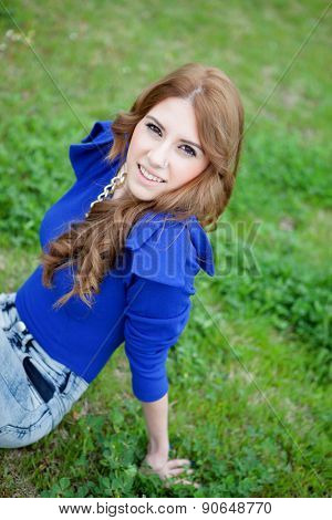 Attractive cool woman dressed in blue and a piercing in her nose