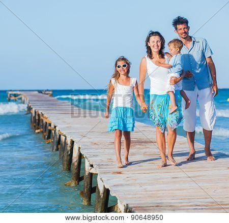 Family walking wooden jetty