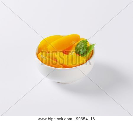 peach compote served in the bowl