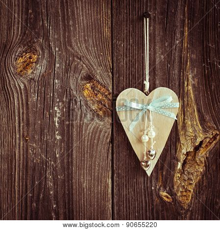 wooden heart hanging on a branch