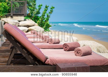 Empty Sunbed With Wrapped Towels On A Beautiful Beach On Sunny Day