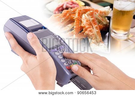 Hand Using Credit Card Machin With Food In Background For Your Restaurant Business