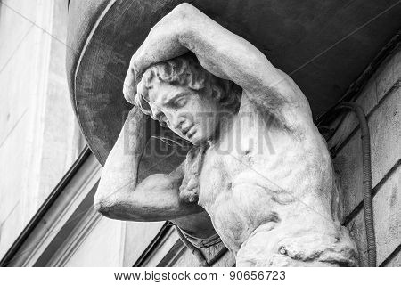 Sculpture Of Atlant On The Facade Of Old House