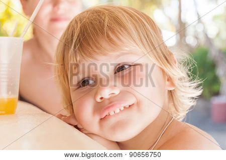 Cute Caucasian Baby Girl With Glass Of Orange Juice