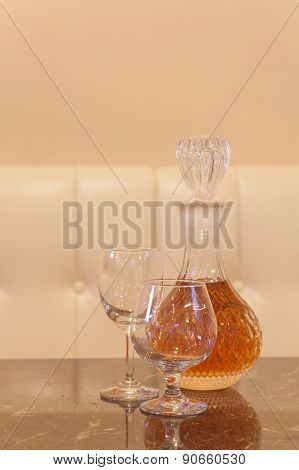 Emty glass and bottle glass of whisky on wood table