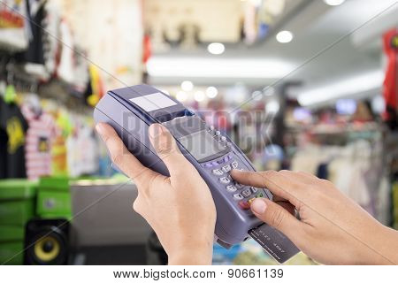 Woman Hand With Credit Card Swipe Through Terminal For Sale In Clothes Store