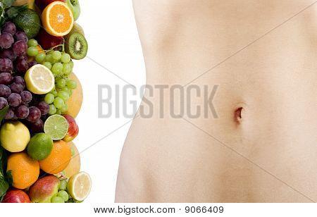 female beautiful body and fresh fruits