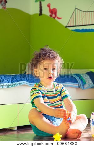 Baby Boy Playing In His Room