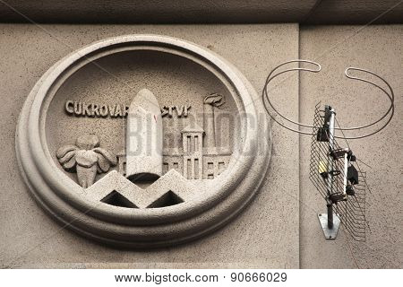 Allegory of Sugar Industry. Building decoration at Bubenecska Street in Prague, Czech Republic.