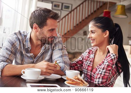 Couple meeting in a cafe