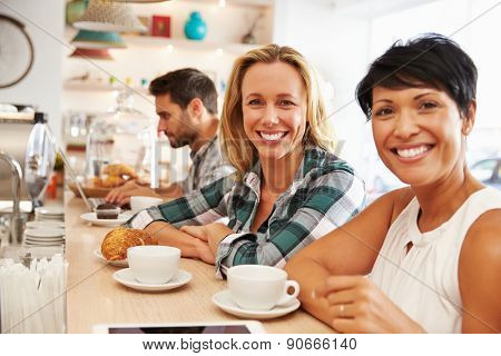 Two women meeting together in a cafe