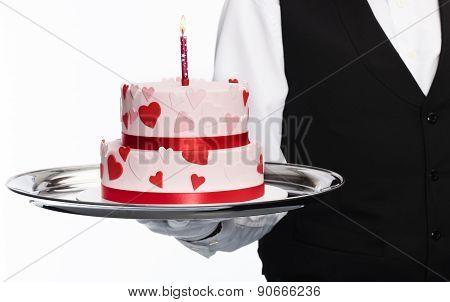 Holding anniversary cake