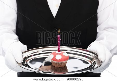 Holding cupcake with candle
