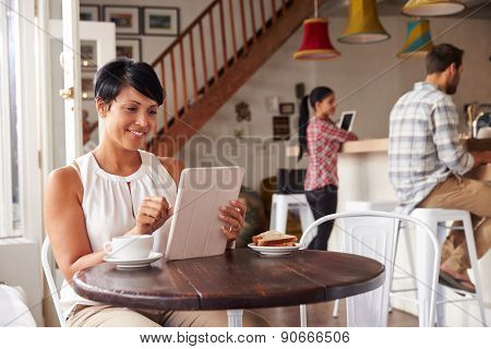 Middle aged woman in a cafe