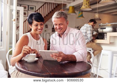 Middle aged couple in a cafe