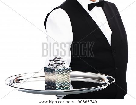 Waiter with gift on tray
