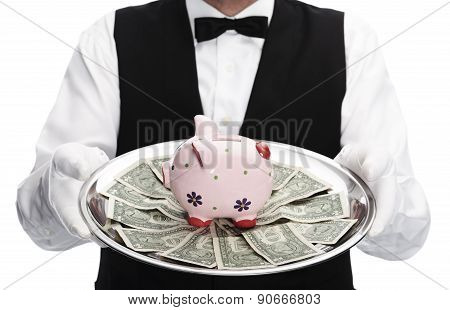 Butler holding tray with piggy bank