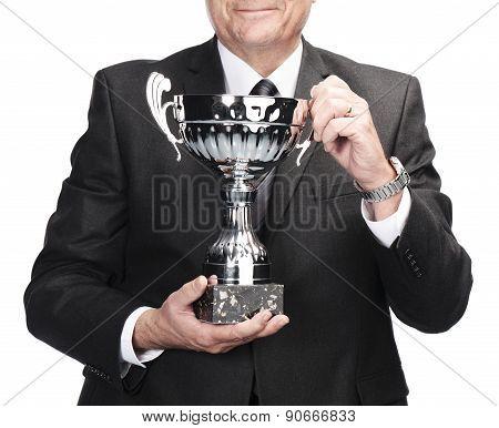 succesful businessman holding trophy