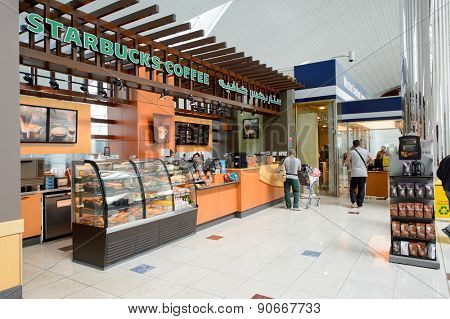 DUBAI, UAE - MARCH 10, 2015: Starbucks Coffee cafe interior. Starbucks Corporation, doing business as Starbucks Coffee, is an American global coffee company and coffeehouse chain based in Seattle