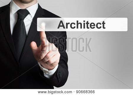 Businessman In Office Pushing Button Architect