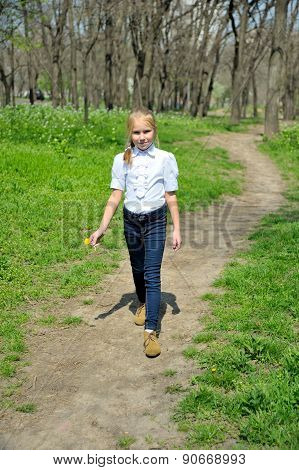 Young girl goes on a footpath