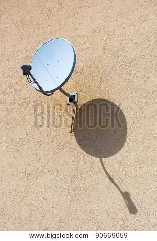 Satellite Dish Mounted On The Wall Of House