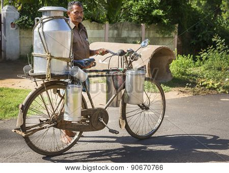 Milkman Carrying Milk Cans On His Bike.