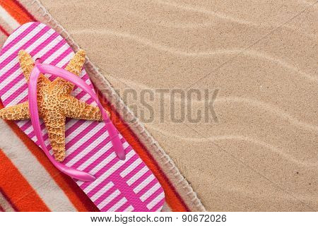 Starfish In A Slap On The Beach