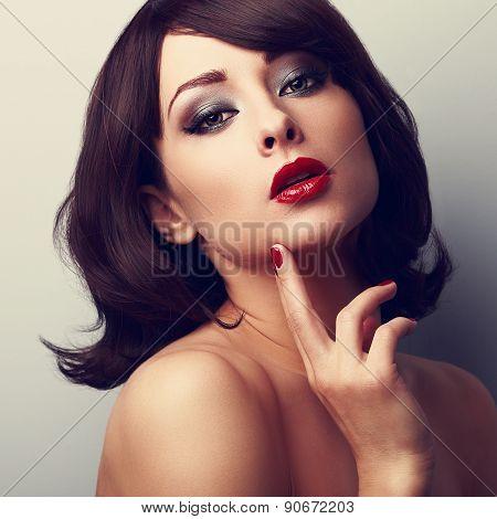 Beautiful Makeup Face Of Female Model. Closeup Color Portrait