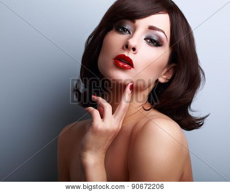 Sexy Hot Makeup Woman With Short Hair And Finger Under Face