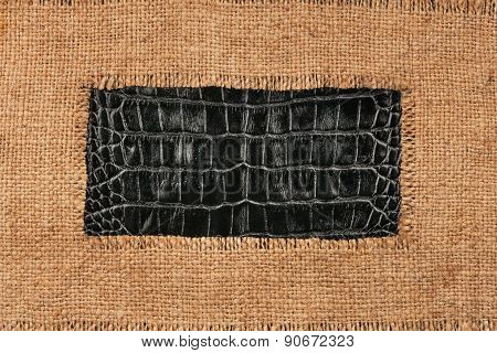 Frame Of Burlap, Lies On A Background Of Crocodile Leather
