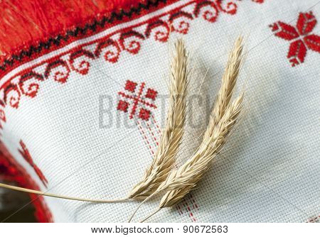 spikelets of wheat on the embroidered towel