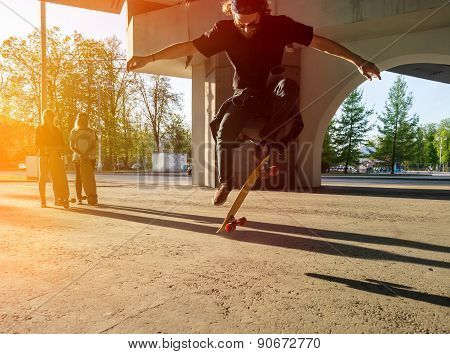 Silhouette Skateboarder Jumping In City