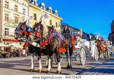 Horse carriages on main square Krakow, Poland