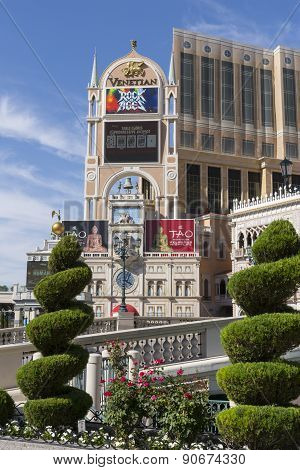 A view of the Venetian hotel sign in daylight.