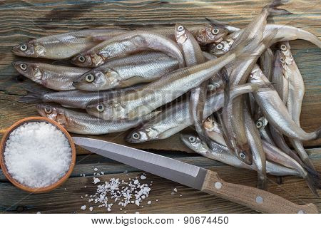 Freshly caught small fish. Smelt on a wooden surface