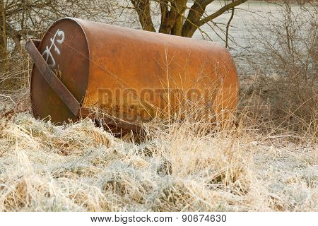 Forgotten old road roller in the grass