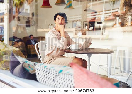 Businesswoman with digital tablet in a coffee shop