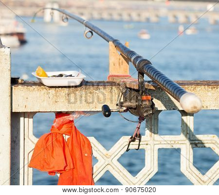 Fishing Rod On The Railing Bridge